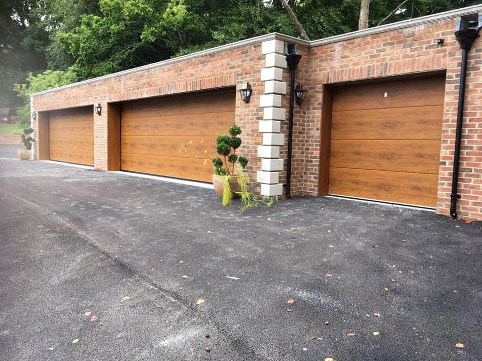3 Carteck sectional doors in Golden Oak fitted in Haywards Heath by Chalfont Garage Doors.